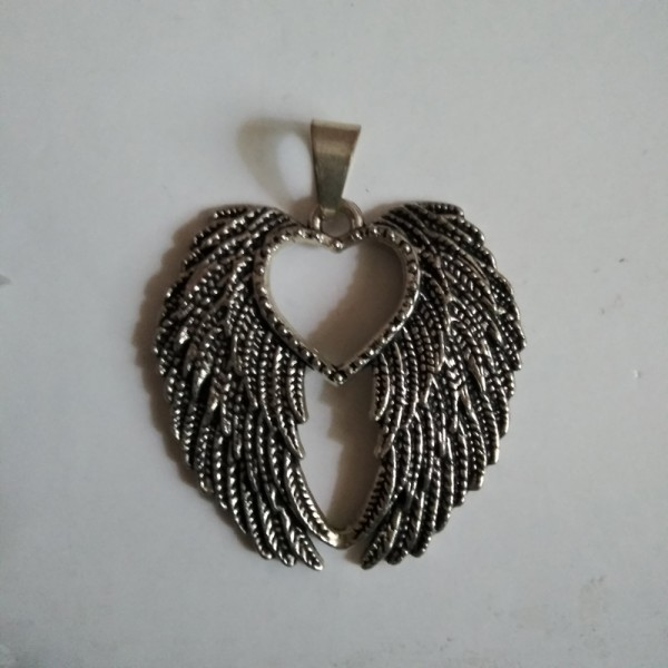 German Silver Feather Pendant with center heart